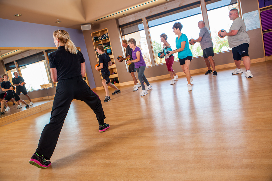 An instructor teaches a class inside a fitness studio at The Gallery Golf Club