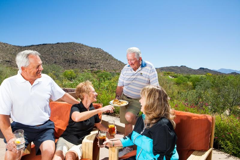 Guests enjoy themselves on the back patio of the bar and grille at The Gallery Golf Club
